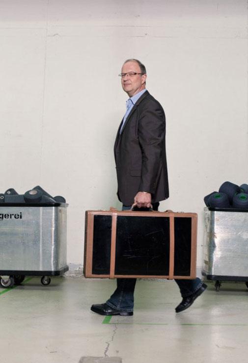 Fraas - Mann mit Koffer